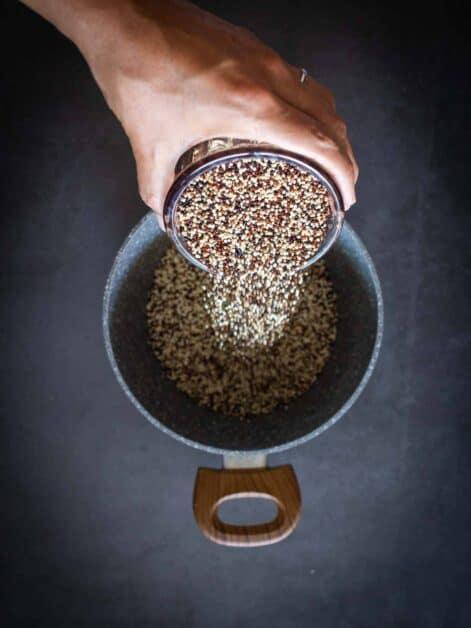 pouring tri-color raw quinoa