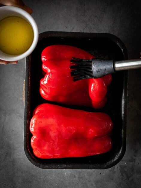 muhammara dip-brushing red-bell peppers with oilve oil