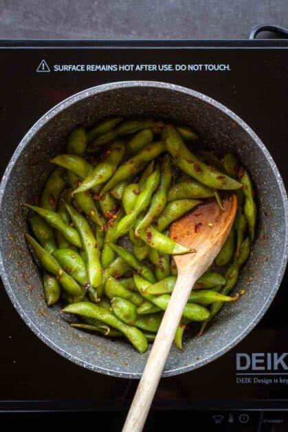 Stirring Garlic Edamame with Seasonings