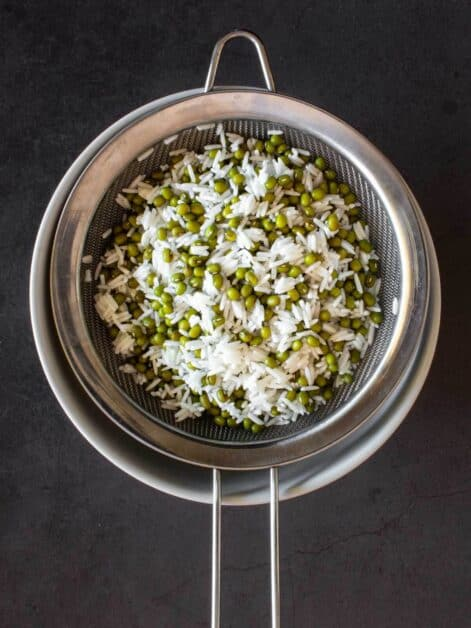 straining moong beans and rice