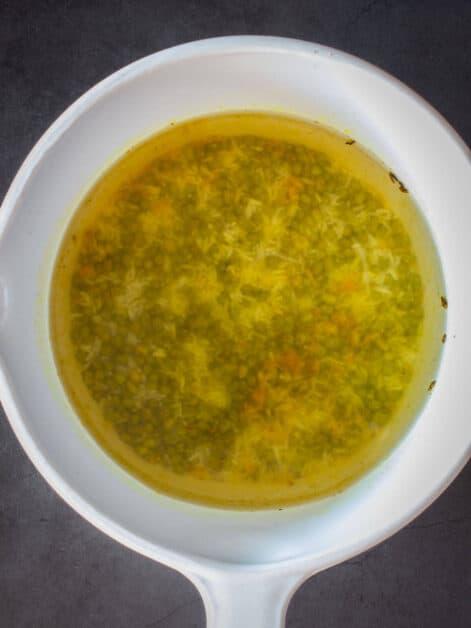 all kitchari ingredients in saucepan