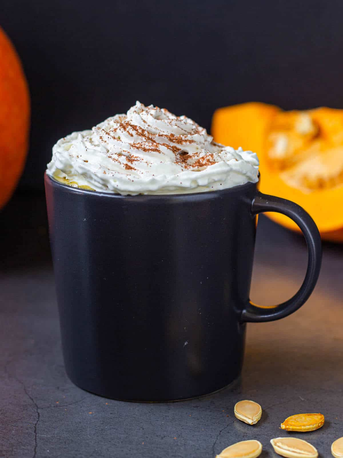 pumpkin spice latte served in mug with whipped cream
