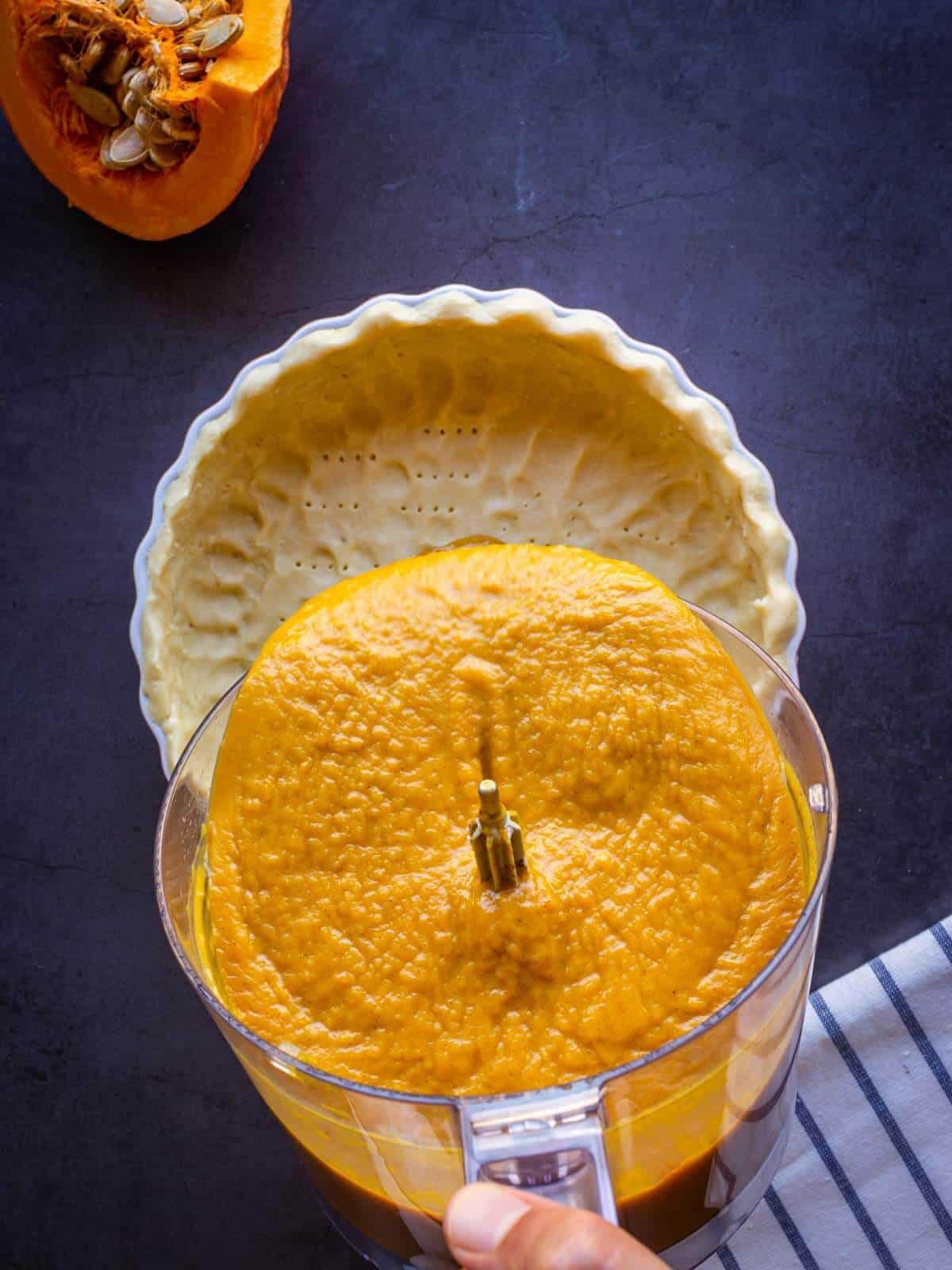 pouring pumpkin pie batter into vegan no-roll pie crust