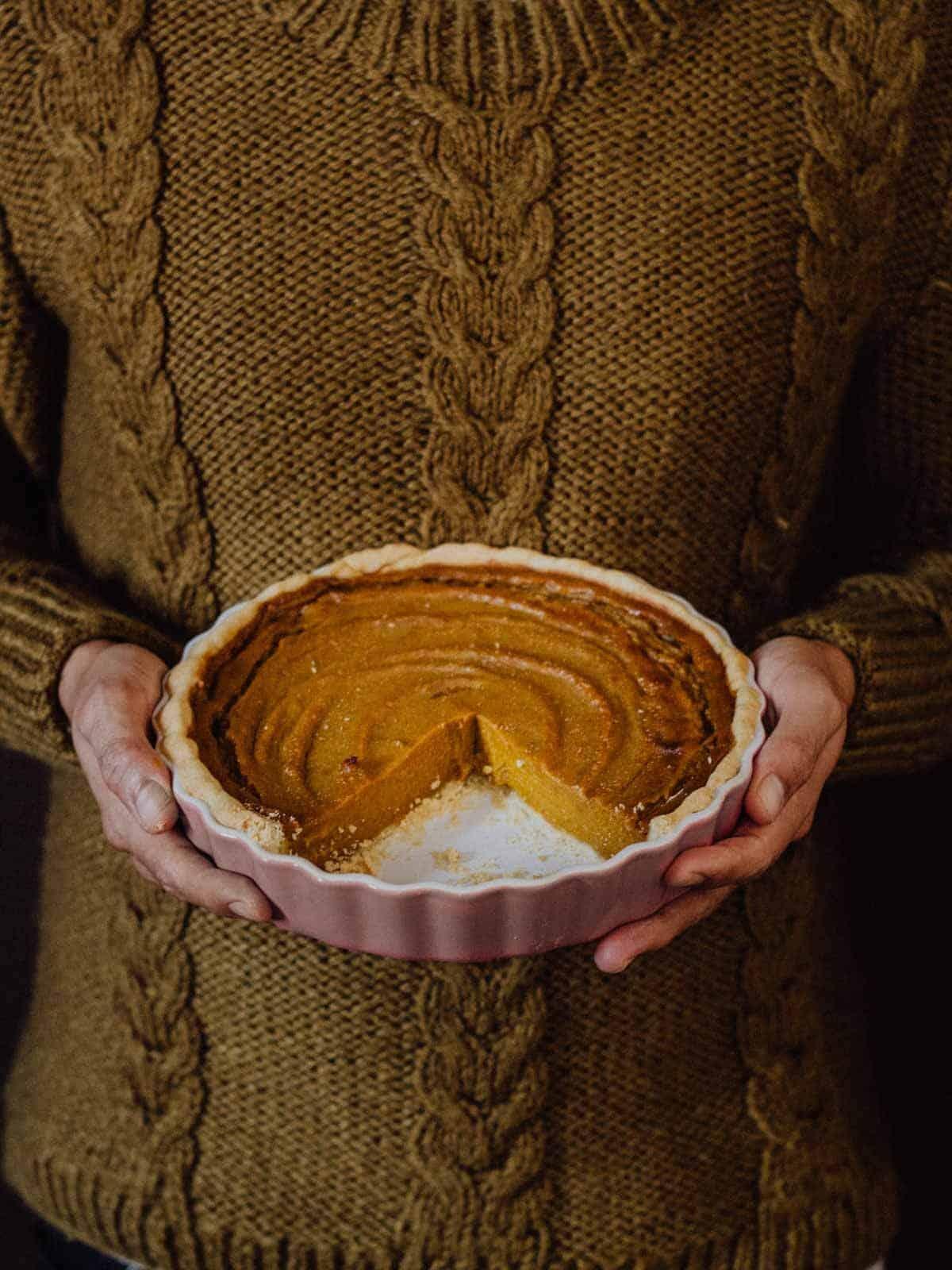 holding vegan pumpkin pie