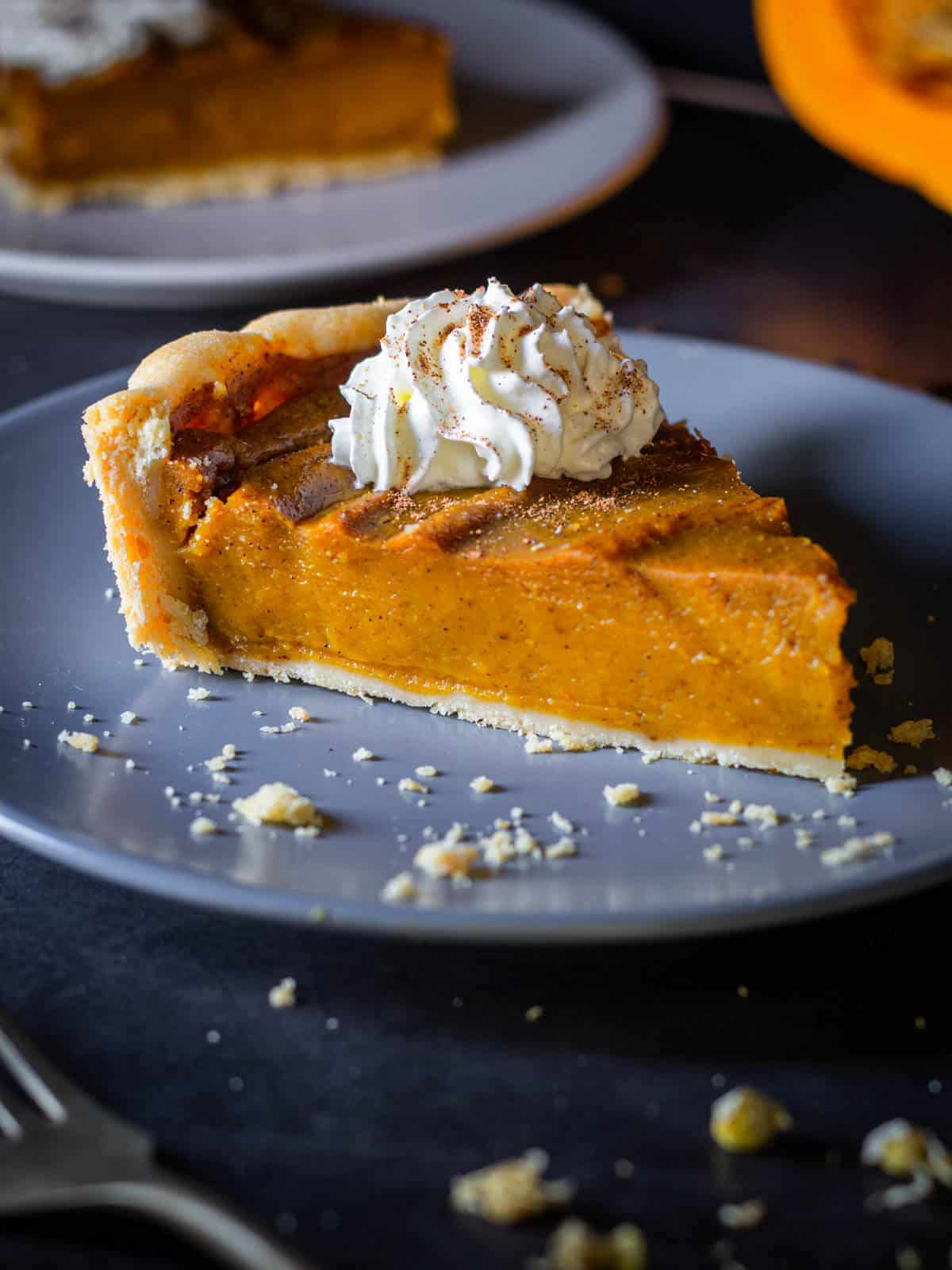 vegan pumpkin pie portion with whipped cream