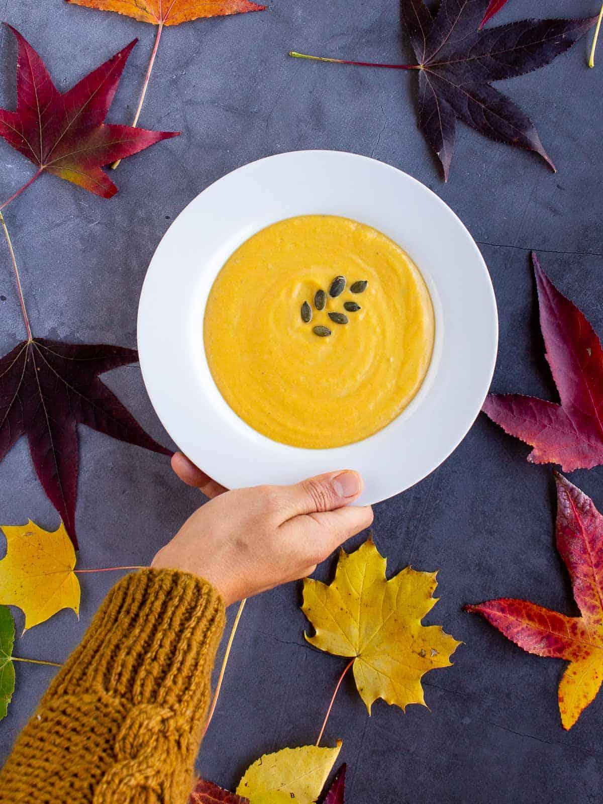 pumpkin tahini soup hand