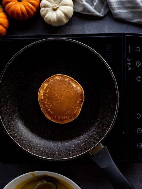 flipping pancakes in nonstick pan