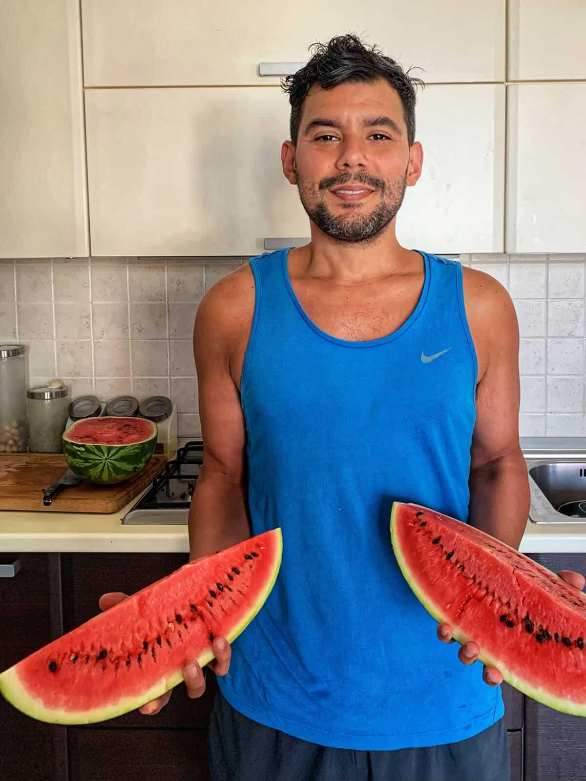 Gustavo holding watermelon