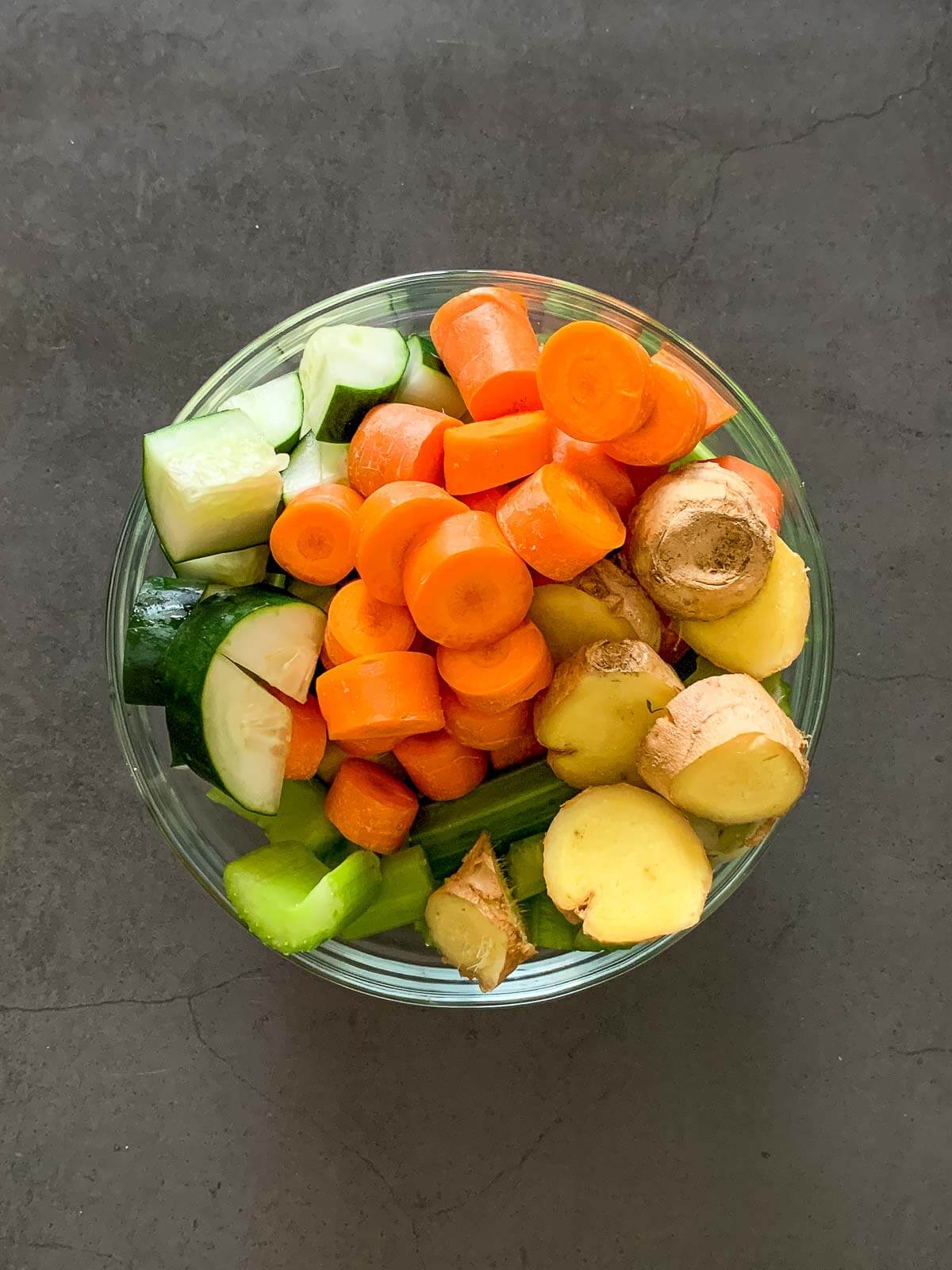 carrot celery cucumber juice ingredients in bowl