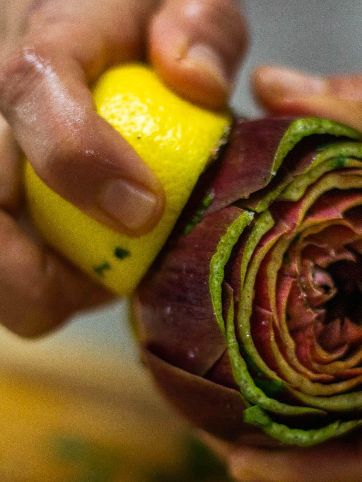Brushing Artichokes with Lemon