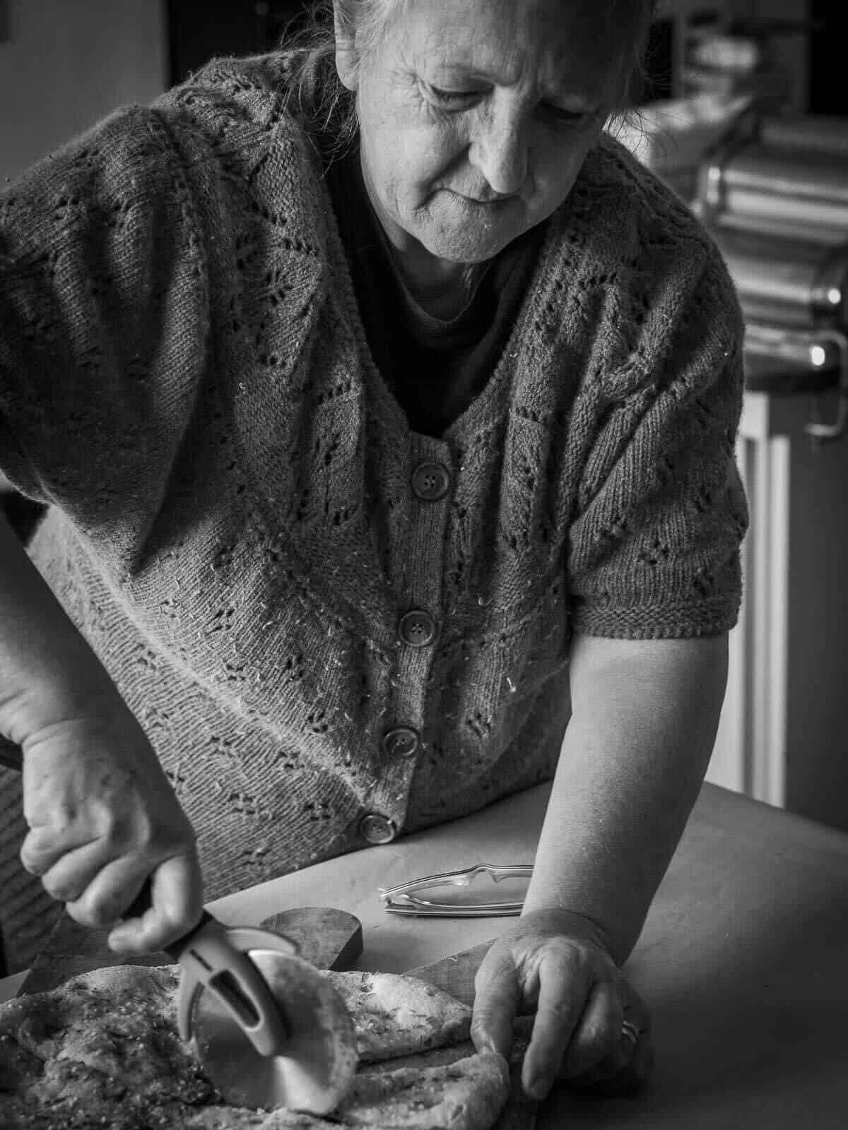 Woman cutting focaccia