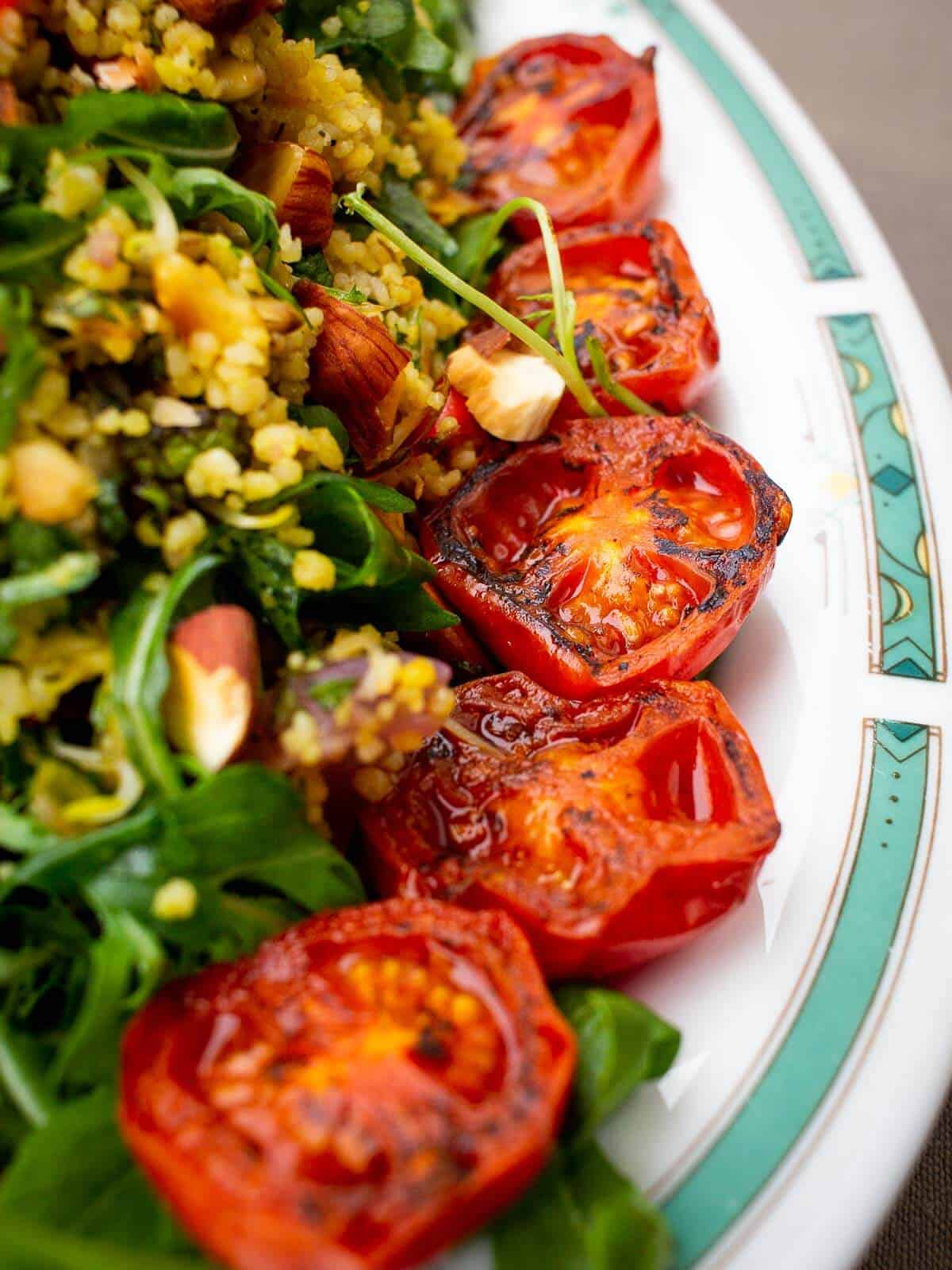 grilled cherry tomatoes-on top of couscous salad