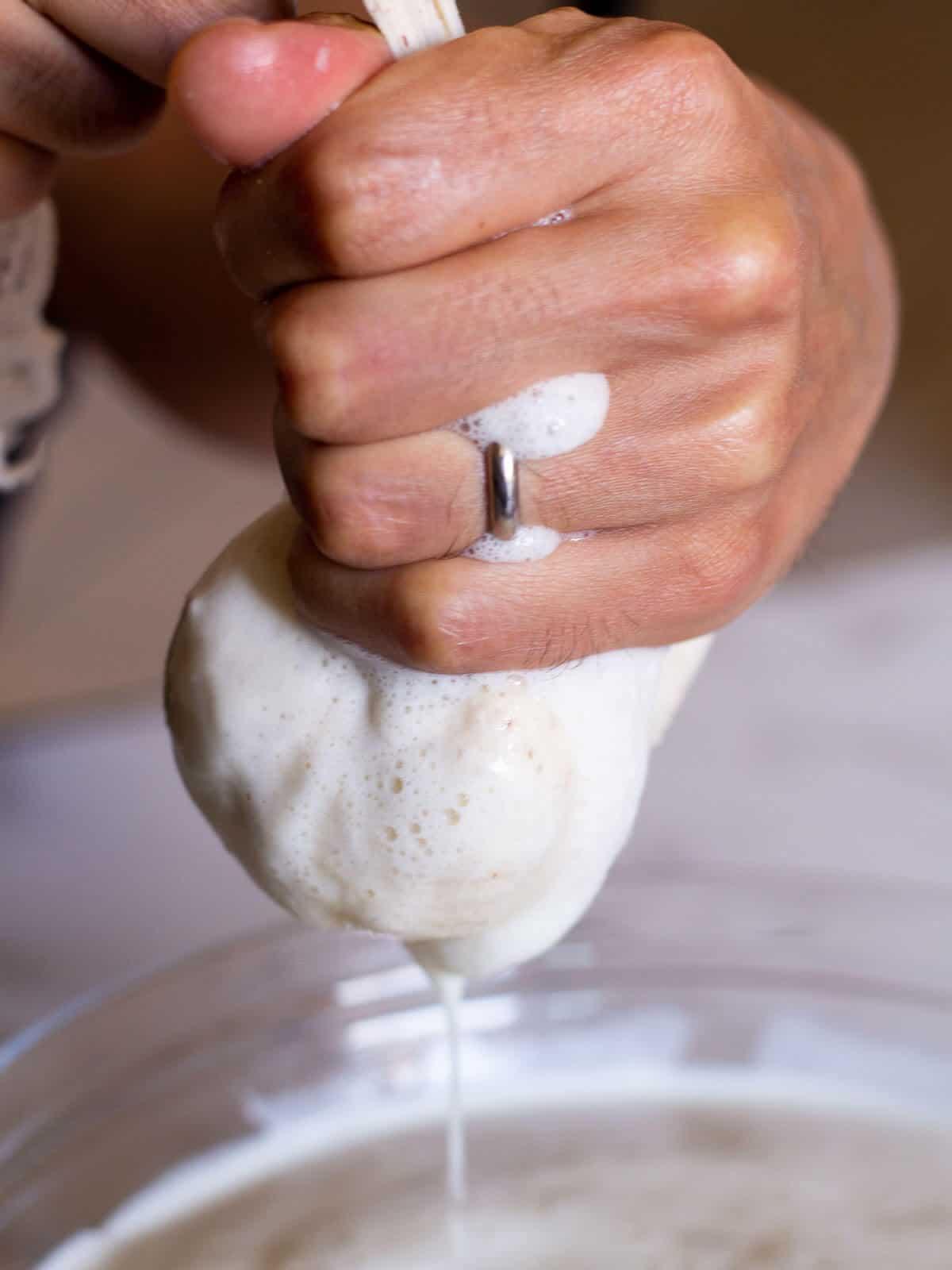 straining soy milk