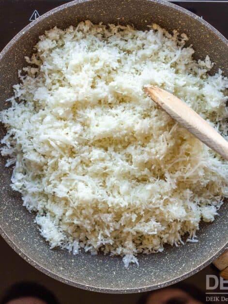 stirring cauliflower rice