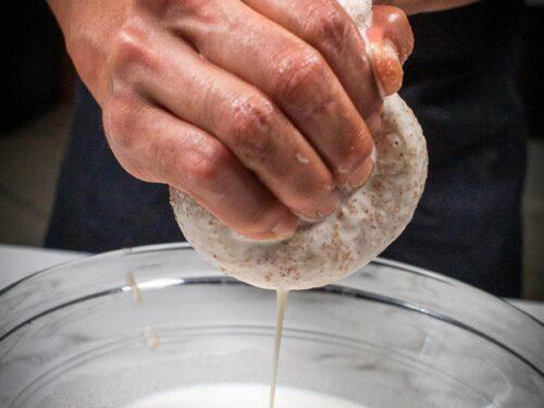straining almond milk