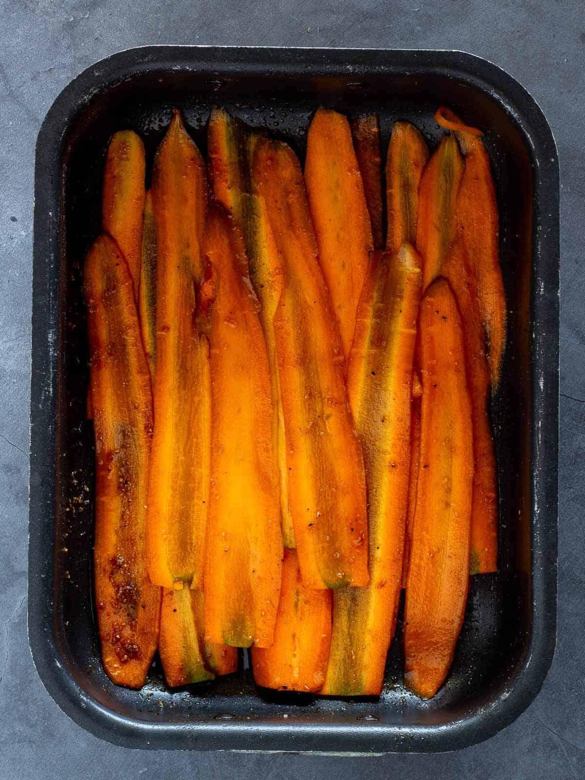 Carrot Bacon Marinade in sallow container