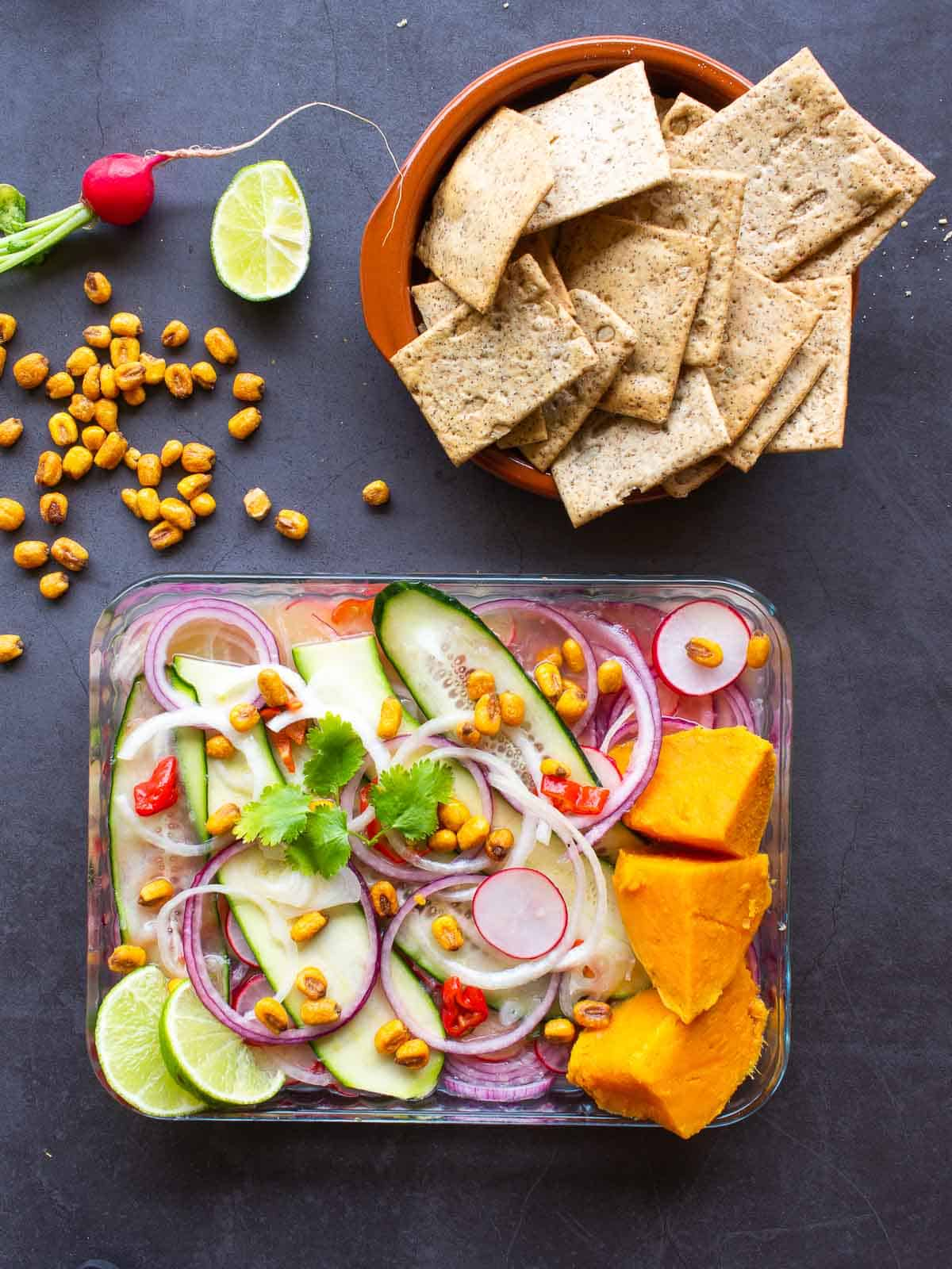 Vegan Ceviche  with sweet potatoes, corn and crackers